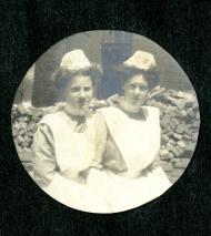 Cornelia Mercer poses for the camera with a fellow nurse, both wearing nurse uniforms