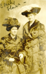 Cornelia Mercer and Emily Flass dressed in fur coats and hats pose for the camera