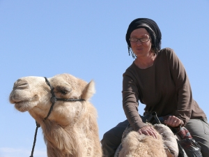 Photograph of Dr. Roberta Casagrande-Kim on a camel.