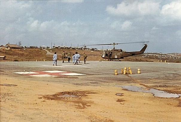 Military Medical Personnel Hurry To A Landing Helecopter 91st Evac