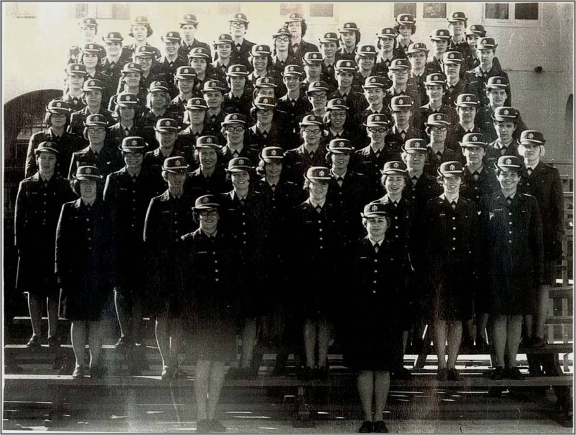 A group of women in uniform pose for an official photograph.
