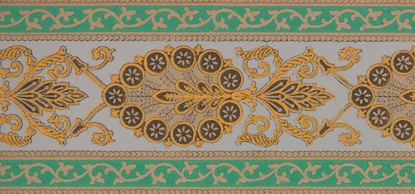 A striped pattern with intricate gold and brown peacock like decorations between green bands.