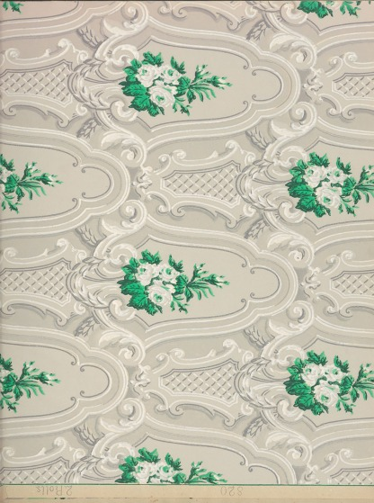A repetative lacy pattern with intermittent depictions of whiteflowers with greenery.