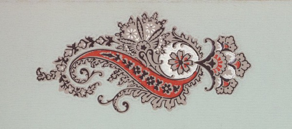 A red, white, and tan paisley on a green background.