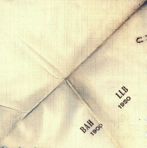 "A napkin with the text ""BAH LLB 1900 1950"" on it"