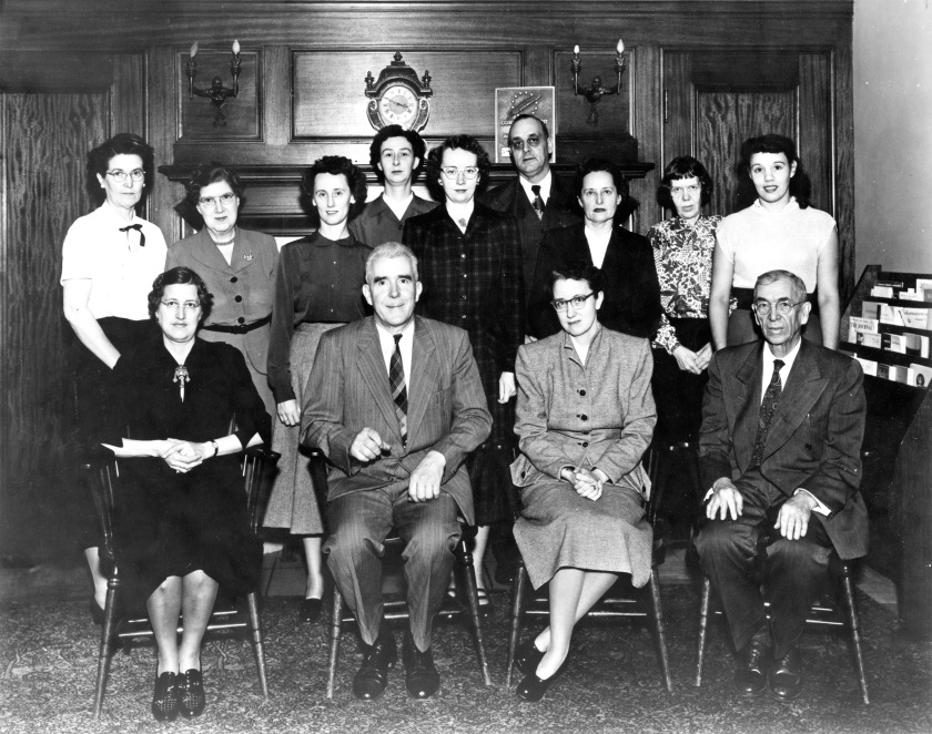 Black and white photograph of the library staff.