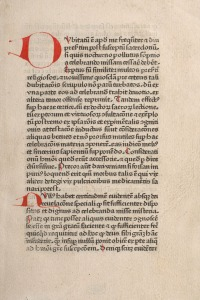 A printed page in Latin in one column with handwritten initial letters in red.