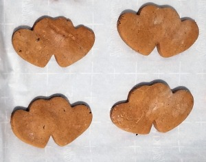 Heart shaped cookies on a baking sheet.