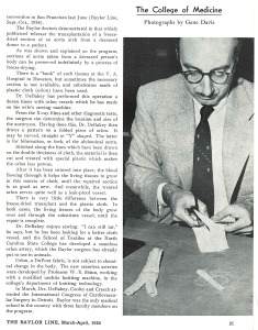 A man in a suit cuts a piece of cloth with scissors.