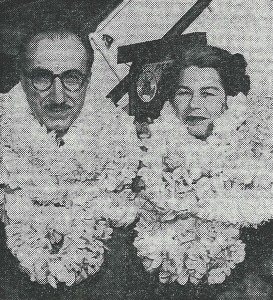 For article, Noted Texas Heart Surgeon Will Treat Honolulu Woman witha photograph of Dr. and Mrs. DeBakey in leis.