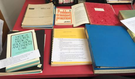 Papers, binders, spiral bound documents and books.