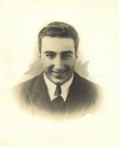 A formal portrait of a young Michael DeBakey
